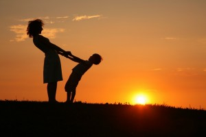 http://www.dreamstime.com/royalty-free-stock-photography-mother-son-sunset-holding-hands-image7092227